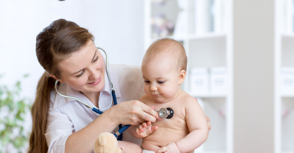 nurse checking the baby's health