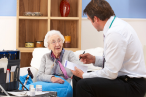 caregiver and elderly woman doing speech therapy