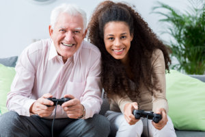 caregiver and elderly man playing